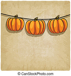 old background with pumpkins on rope