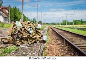 Old backpack on old abandoned train station