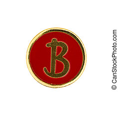 Macro shot of a vintage badge with gold edge & red enamel with the letter B in gold embossed in the middle.