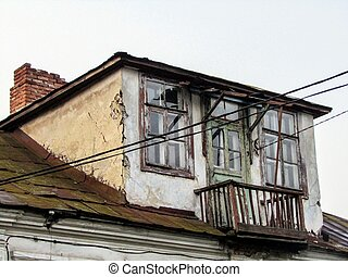 old balcony on the roof of the house. photo