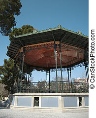 Old bandstand structure with iron and wood.