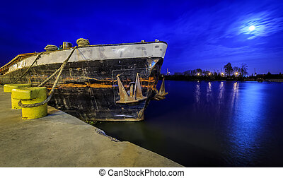 Old barge at night