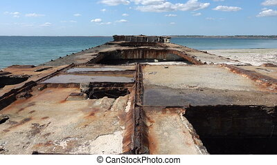 Old sunken rusty barge on the Black Sea