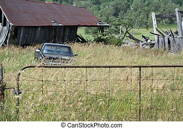 Old Barn and Truck in Field