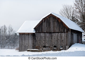 Old Barn Covered in Snow