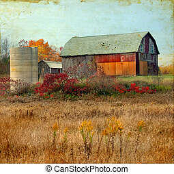 Old barn in the autumn on a grunge background.
