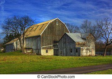 Old Barn - An old weathered stone and wood barn on a crisp...