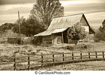 Old barn in pasture with sepia tint.