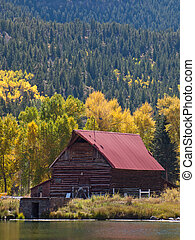 Old Barn - Old barn by the lake in autumn. Near Lake City,...