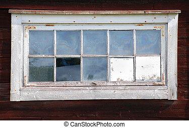 broken window on an old barn