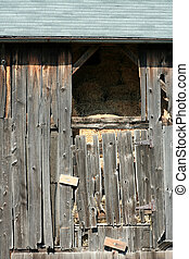 Old barn with hay - An Old wooden barn with bails of hay