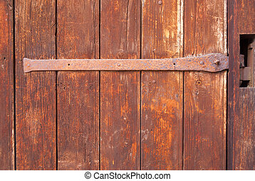 old barn wooden door with forged loop