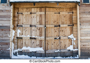 Old barn wooden gates closeup
