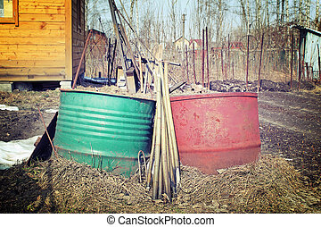 Old barrels for water in the site of a country house