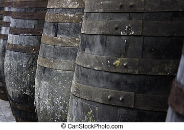 Old barrels stacked in rows