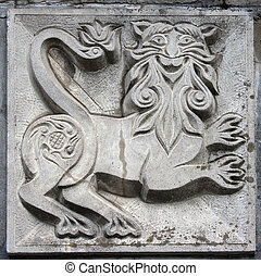 old bas-relief of fairytale animal - old bas-relief of...