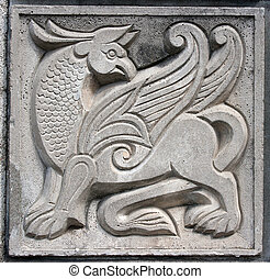 old bas-relief of fairytale winged lion - old bas-relief of...