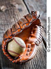 Old baseball ball and glove