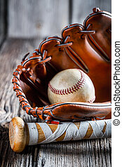 Old baseball bat and glove with ball