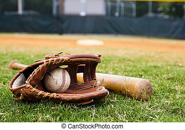 Old Baseball, Glove, and Bat on Field - Old baseball, glove...