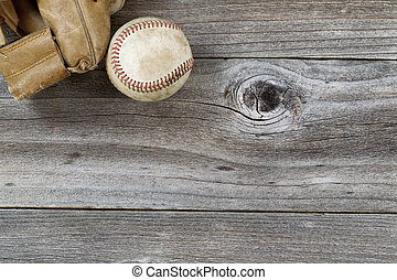 Old Baseball Mitt with used ball on rustic wood - Horizontal...