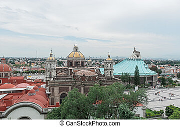 Old basilica and the modern basilica in Guadalupe, Mexico. -...
