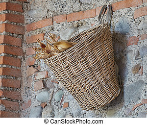 old basket hanging on wall