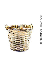 Old basket made of reed isolated on white background