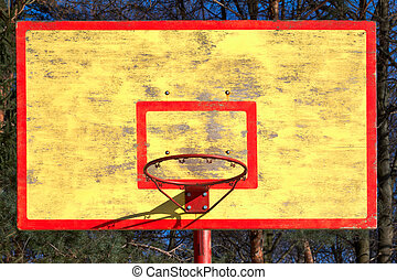 old basketball backboard and ring without grid