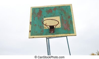 old basketball hoop outdoors sport rusty iron ball enters...