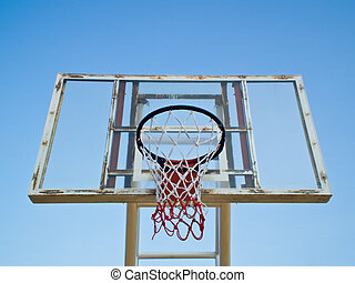 old basketball hoops on blue sky background