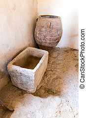 Old bathroom and toilet in Museum with artifacts of ancient...