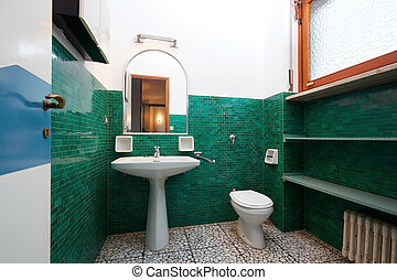 Old bathroom in normal apartment interior