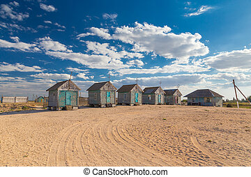 old beach huts on the sand