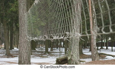 Old beach volleyball net - Close-up shot of old net on the...