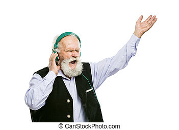 Old bearded man listening music