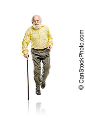 Old bearded man walking with cane - Old active bearded man...
