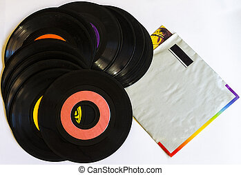 Old beat up 45s and their paper sleeves. Lots of scratches, dust and wear. Isolated on a white background.
