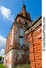 Old beautiful orthodox bell-tower in Russia. Ruins.