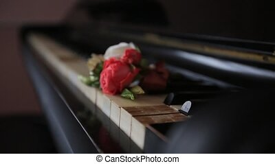 old beautiful piano with bouquets of flowers