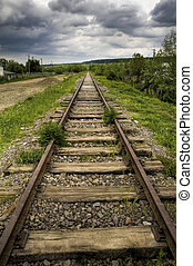 old beautiful railroad - vintage railway with dramatic sky