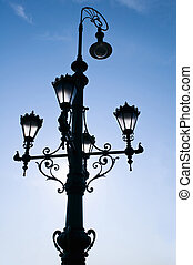 Old beautiful street lamp in Budapest at sunrise