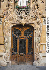 Old beaux-arts doors in Paris, France - Old ornate wooden...