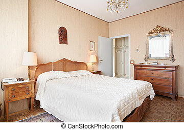 Old bedroom with queen size bed