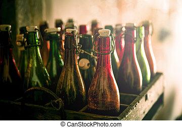Old beer bottles in wooden cases