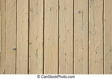 Old beige painted wooden fence close up.