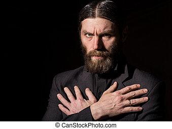 Old Believer Senior Prayer, bearded old man praying on a dark background
