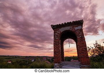 old bell tower at sunset