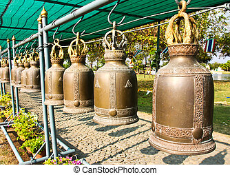 Old bells in a buddhist temple of Thailand.