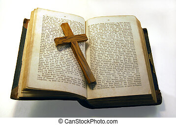Old bible and cross - A very old bible with a cross in it.